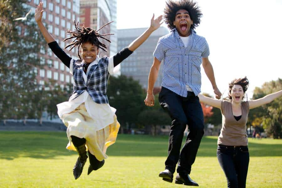 Students jumping for joy for free college